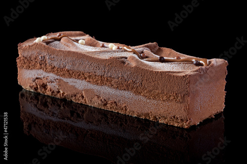 Chocolate cake on black background