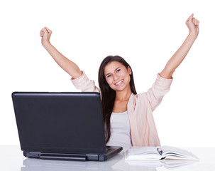 Happy female office worker rejoicing