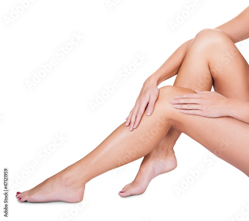 Woman caressing her silky smooth legs
