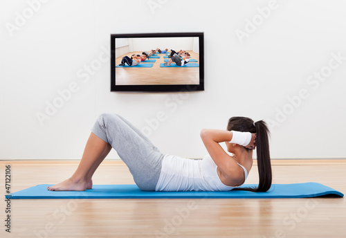 Athletic woman working out at home