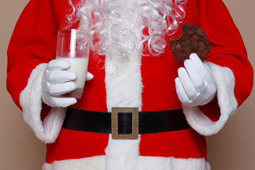 Santa Claus holding milk and cookies
