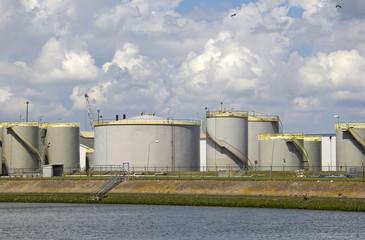 Oil silos along a canal