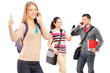 A happy male and female student using a mobile phones