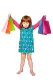 red-haired girl with shopping bags enjoying purchases