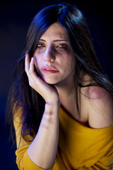 Woman destroyed by domestic violence wound and brooses
