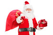 A Santa Claus holding a bag full of presents and gift