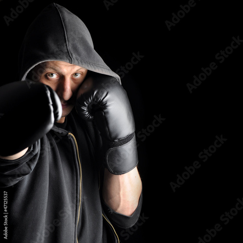 Young boxer over dark background