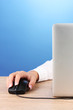 woman's hands pushing keys of pc mouse,