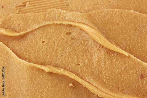 Delicious peanut butter close-up background