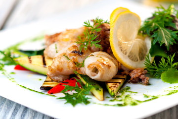 grilled squid on plate