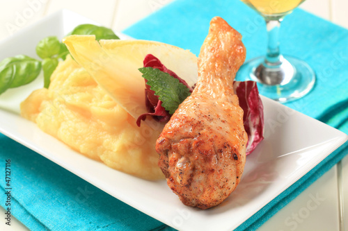 Roast chicken drumstick with mashed potato