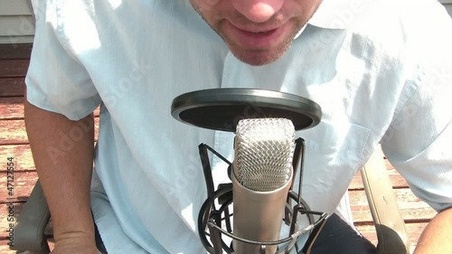 Man Behind Microphone in Sun