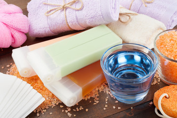 Body care accessories: towels, sea salt, soap, pumice stone and