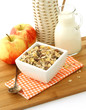 muesli of oats with raisin and the apples on wooden