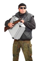 Dangerous gangster with gun and stolen money in suitcase.
