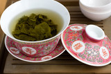 A chinese gaiwan with tea on a tea table