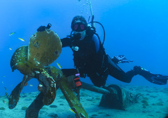 Woman scuba diver on the Gregory, a wreck in St Maarten