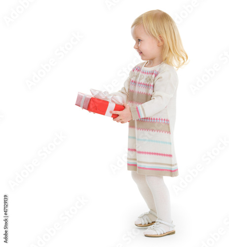 Happy baby girl holding Christmas present box
