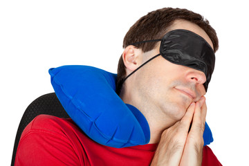 man with travel Neck Pillow and Sleeping mask sleep in a armchai