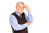 Portrait of a mature man holding his head in pain