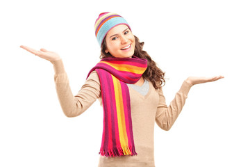 Young relaxed female gesturing with her hands