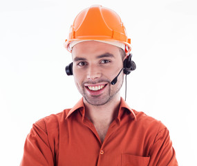 A builder with headphones