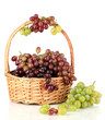 Delicious ripe pink and green grapes in basket isolated on