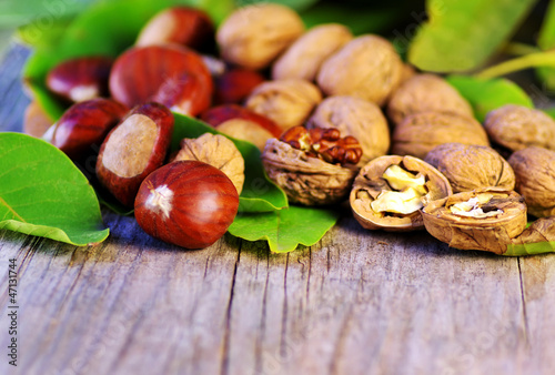 chestnuts and walnuts on wooden table