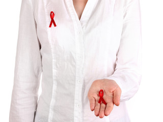 Woman with red ribbon in hands on isolated on white
