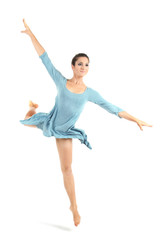 young beautiful dancer in a blue dress in photostudio