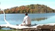 Man Staring at Fall Colors at Lake