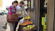 Couple looking at fresh fruits in grocery store, steadicam shot