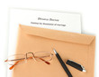 Divorce decree and envelope on white background
