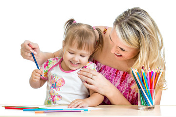 mother and her child fun games with color pencils