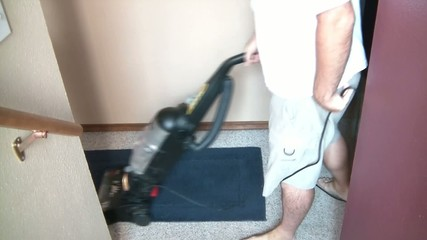 Man Vacuuming Floor