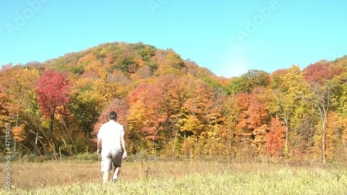 Man Hiking in Fall Season - Waving In