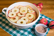 Bowl of sliced apple rings with cinnamon