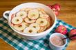 Bowl of sliced apple rings with cinnamon