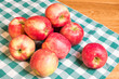 Apples on green and white cloth