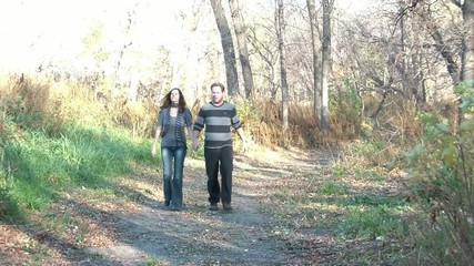 Couple on Date Walks Through Woods