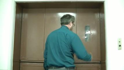 Man Opening Elevator Doors