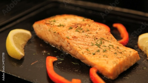 Juicy salmon fillet cooking on hot barbecue. Locked down.