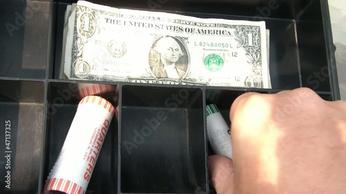 Opening Coin Rolls in Cash Box