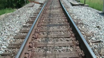 Pan up Railroad Tracks in Sun