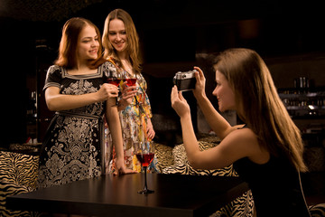 Three young woman having fun in the fancy nightclub.