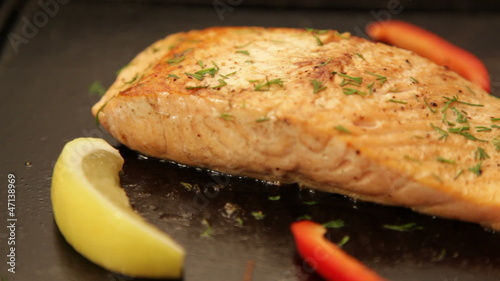 Juicy salmon fillet cooking on hot barbecue. Dolly shot LR.