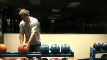 Man Picking Out Bowling Ball