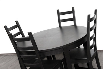 brown round table against white wall