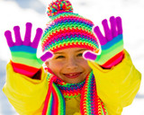 Winter fun, happy girl enjoying winter