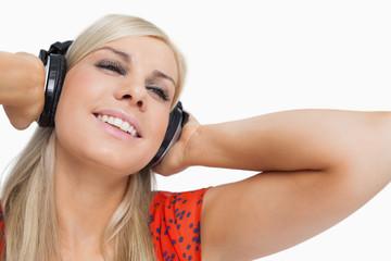 Happy blonde listening to music